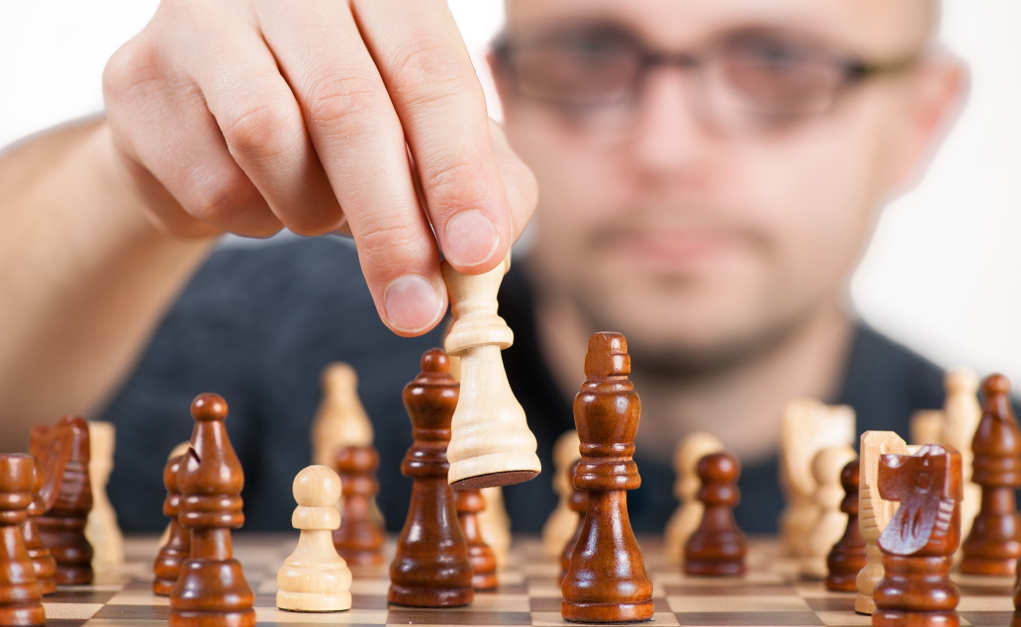 Chess player considering strategy
