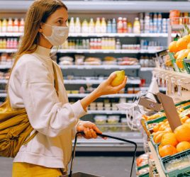 Shopper looking at fruit
